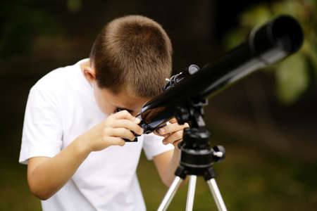 telescopes: little boy with telescope Stock Photo