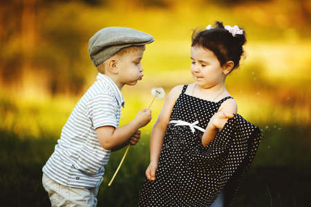 love blow: cute boy and girl Stock Photo