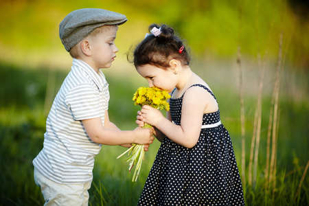 little boy and girl: cute boy and girl on summer field
