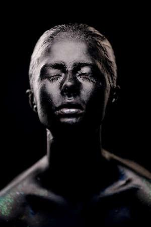 girl in black paint on dark background Stock Photo - 17958291