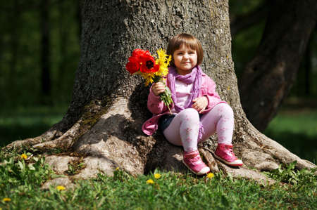 little sweet girl with flowers photo