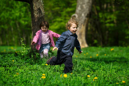 little boy and girl running away photo
