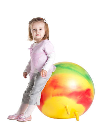 little girl sitting on fitball photo