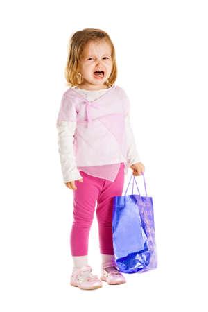 child crying: chica triste con el bolso de compras Foto de archivo