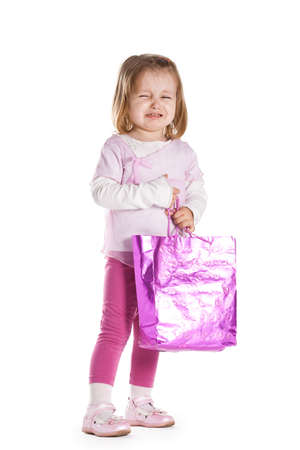 little sad girl with shopping bag photo
