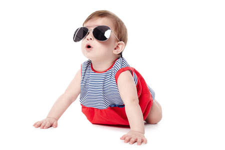 cute happy baby with sunglasses isolated on white background photo