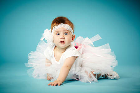 cute little ballerina on blue background photo