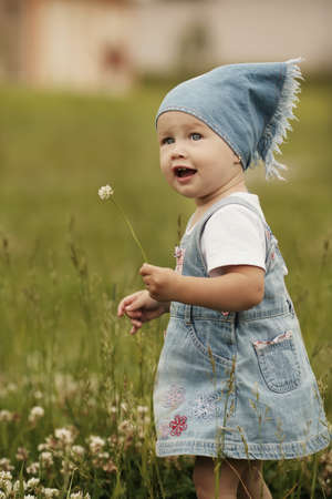 sweet little girl with flower