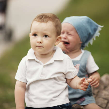 little boy and crying girl photo