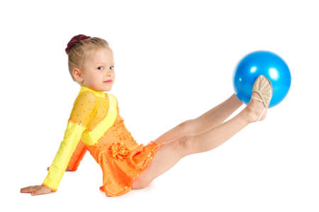 Beautiful girl gymnast with a ball isolated on white photo
