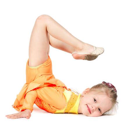 Little gymnast girl isolated on white background photo