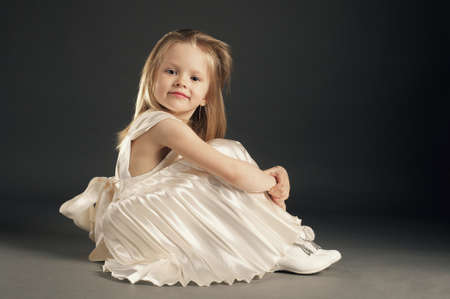 little blond beautiful girl with long hair photo