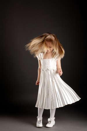 dance preteen: little beautiful girl dancing