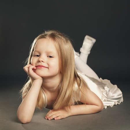 little model: little blond beautiful girl with long hair Stock Photo