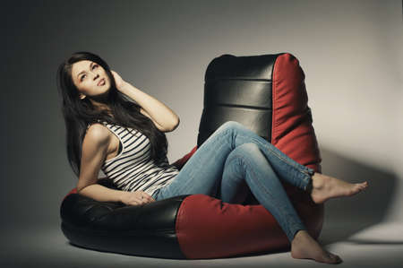 long bean: beautiful brunette lying on bean bag