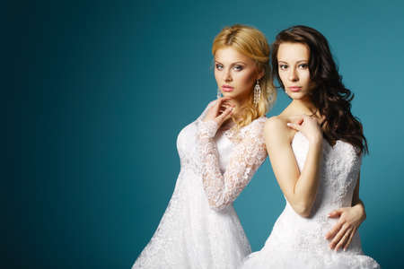 two lovely blonde and brunette bride photo