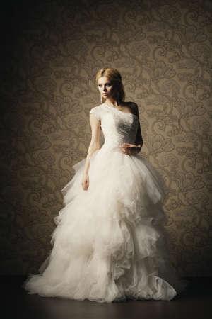 nude bride: beautiful girl in wedding dress