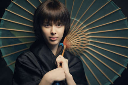 beautiful girl with aged japan umbrella photo