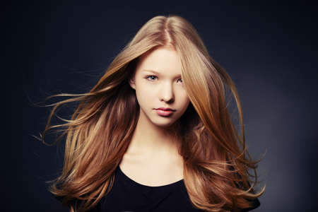 long blonde hair: beautiful teen girl portrait with windy hair Stock Photo