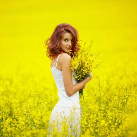 young beautiful girl in yellow field Stock Photo
