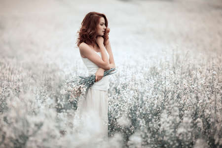 young beautiful sensual girl in the field Stock Photo