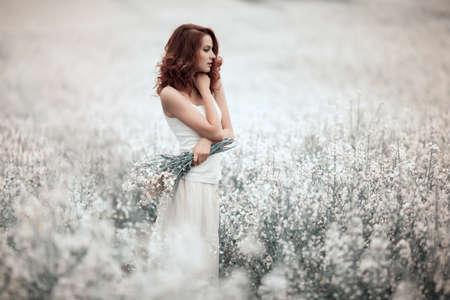 young beautiful sensual girl in the field 写真素材