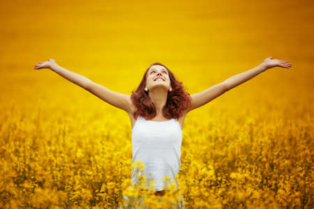 young beautiful girl in yellow field Stock Photo