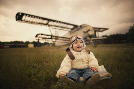 sweet little baby dreaming of being pilot Stockfoto