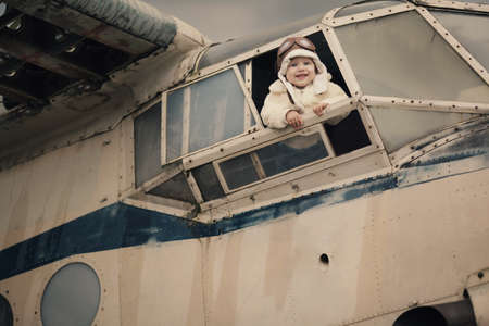 sweet little baby dreaming of being pilot photo