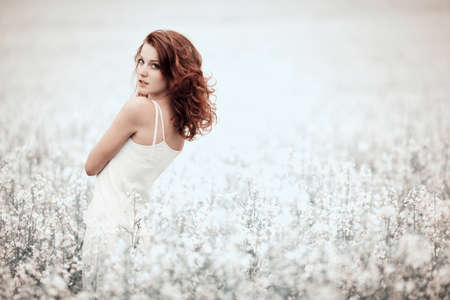 outdoor glamour: young beautiful girl in the field Stock Photo