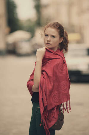 young beautiful red haired girl urban portrait photo