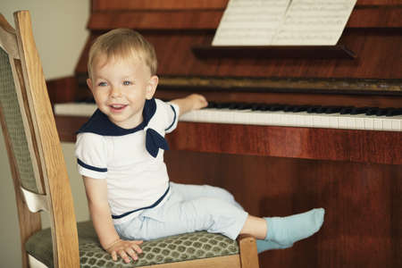 little funny boy plays piano Stock Photo - 21454838