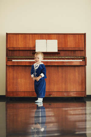 little funny boy plays piano Stock Photo - 21454843