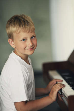 little funny boy plays piano Stock Photo - 21454871