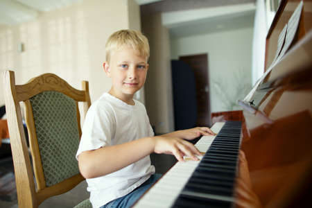 little funny boy plays piano Stock Photo - 21454873