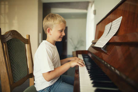little funny boy plays piano Stock Photo - 21454874