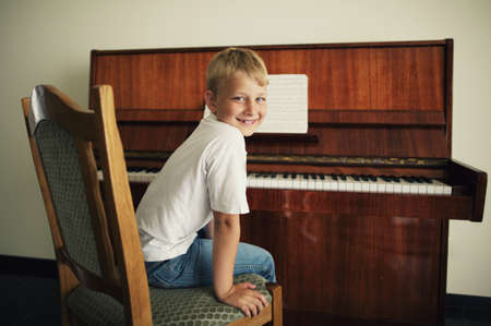 little funny boy plays piano Stock Photo - 21454876
