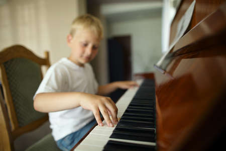 little funny boy plays piano Stock Photo - 21454877