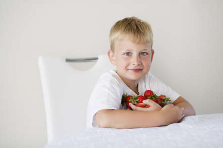 little funny boy with strawberries Stock Photo - 21454882