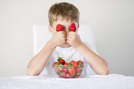little funny boy with strawberries