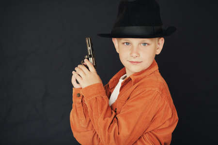 little boy with black hat and gun photo