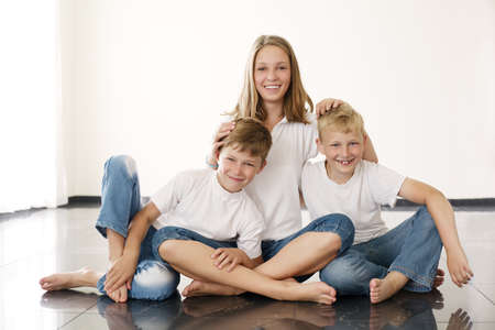 young beautiful girl with brothers photo