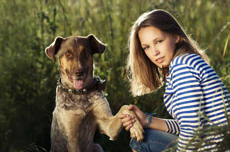 beautiful teen girl with dog photo