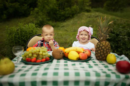 cute boy and girl on picnic in park photo