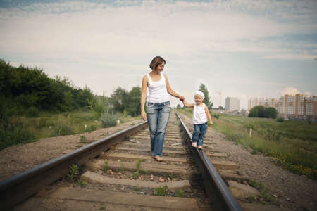 happy parents with baby on railroad photo