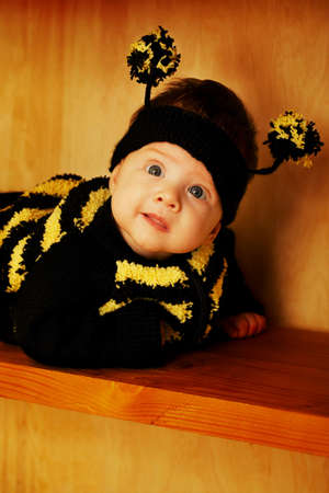 little funny baby with bee costume photo