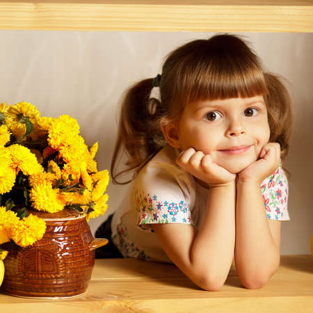 little cute girl with a pot of honey photo