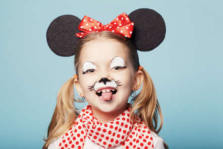 little beautiful girl with mouse mask photo