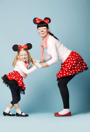 two beautiful girls with mouse masks photo