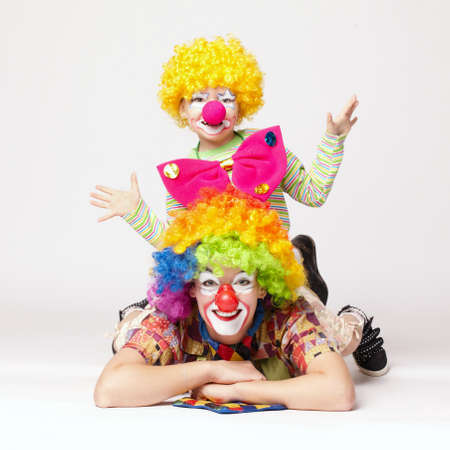 clowns: big and little funny clowns photo Stock Photo